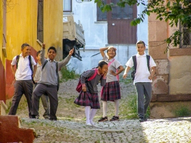 School children having some fun on the way to school in Ayvalik.