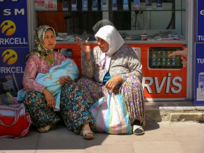 Village women rest from a morning of intense shopping.
