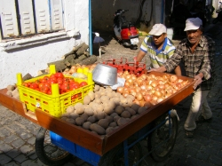 Street vendors still push carts of produce door to door through the narrow lanes of Ayvalik.